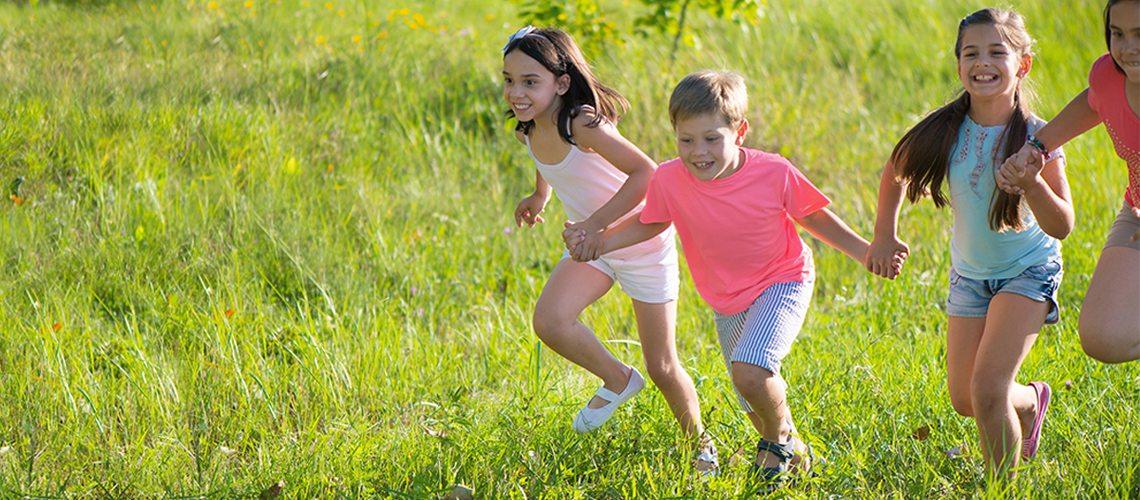 Tops Day Nursury children running through a field