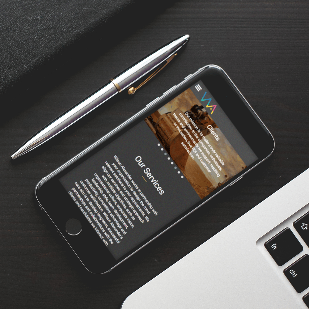 Wilson Alexander mobile website on a desk